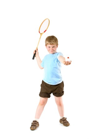 Young boy playing badminton, isolated on white. photo