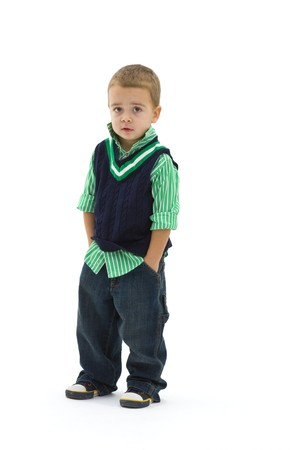 Portrait of preschoold boy posing green shirt and jeans, isolated on white. photo