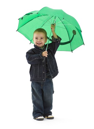 Portrait of young boy wearing jeans jacket, holding green umbrella. Isolated on white background. photo