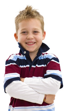 only boys: Young boy posing arms crossed, wearing trendy colorful t-shirt, smiling. Isolated on white background.