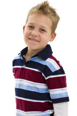1 person only: Studio portrait of young boy wearing trendy colorful t-shirt, smiling. Isolated on white background.