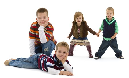 Group of 4 happy children posing together.  smiling. Isolated on white background. photo