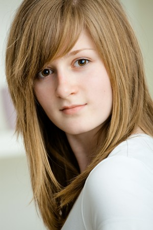 Closeup portrait of teenage girl with long blond hair and big brown eyes, smiling. Stock Photo - 7347770