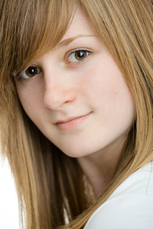Closeup portrait of teenage girl with long blond hair, smiling. Isolated on white background. Stock Photo - 7347772