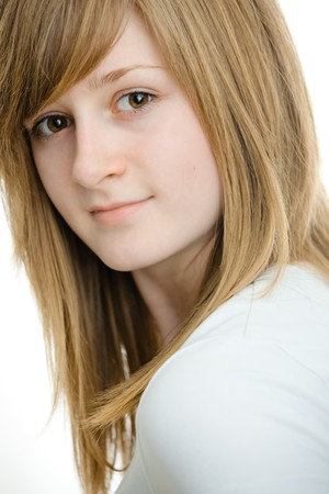 Closeup portrait of teenage girl with long blond hair and big brown eyes, smiling. Isolated on white background. photo
