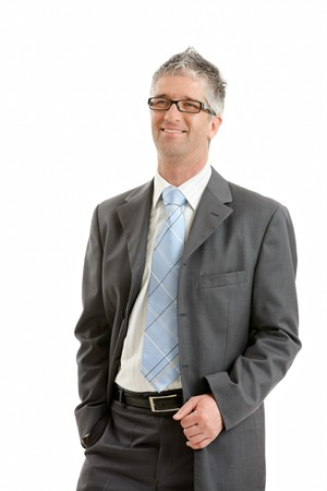 Portrait of happy businessman wearing gray suit and glasses, smiling. Isolated on white background. photo