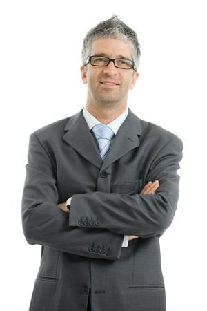 standing alone: Portrait of businessman wearing gray suit and glasses, standing with arms crossed, smiling.  Isolated on white background.