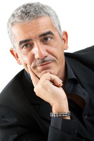 Portrait of mature man thinking, isolated on white background. photo