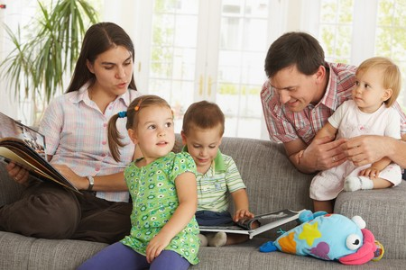 Nuclear family: parents with three children at home having fun. Stock Photo - 7434959