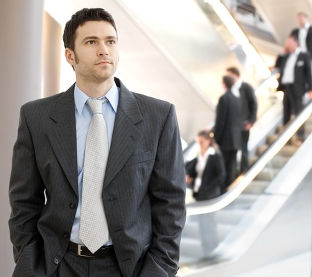 formal attire: Portrait of successful young businessman at corporate location. Stock Photo