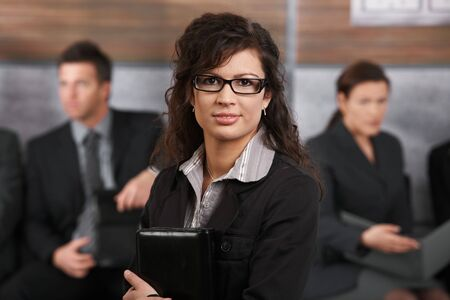 Closeup portrait of happy young businesswoman with glasses, smiling. photo