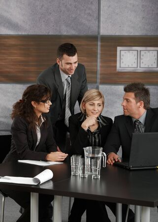 Businesspeople working together on meeting at office. photo