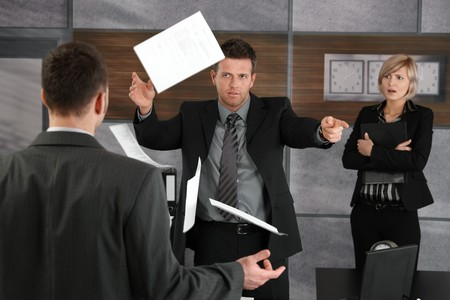 fail: Disappointed director rejecting business report, throwing away papers, pointing out of frame.