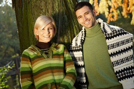Outdoors portrait of smiling couple looking at camera. photo