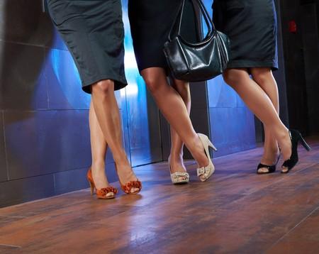 long skirt: Female legs in stocking and elegant high heel shoes.
