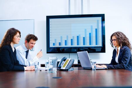 consulting room: Happy business people having meeting at modern office, smiling. Stock Photo