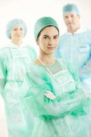 Portrait of confident operation crew in scrub suit, smiling at camera. photo