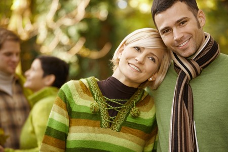 stockphoto: Closeup portrait of young couple embracing in autumn park. Stock Photo