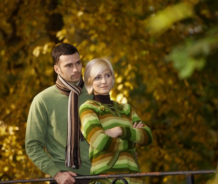 Outdoors portrait of couple in love, embracing autumn park. photo