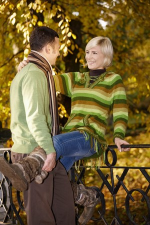 stockphoto: Portrait of happy couple having fun in autumn park. Stock Photo