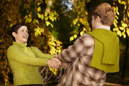Portrait of happy couple having fun in autumn forest. photo