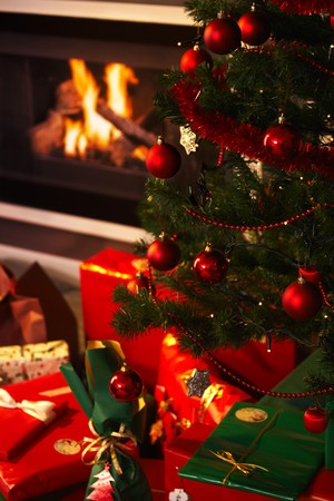 christmas presents and christmas tree in the living room.%uFFFD photo