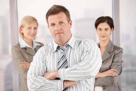 Team portrait of confident mid-adult professionals, looking at camera. Stock Photo - 7792129