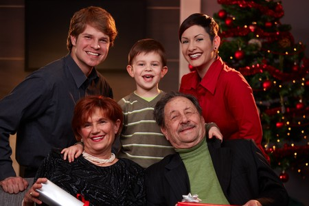 Portrait of happy family at christmas eve, looking at camera, smiling. photo