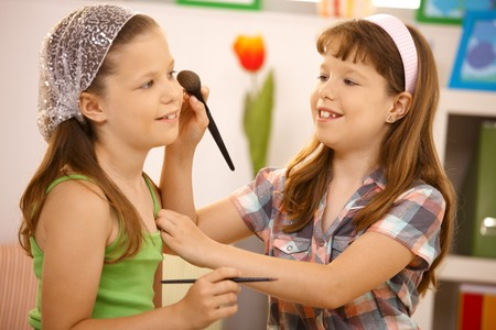 Little girl friends having fun with makeup at home, smiling. Stock Photo - 7899257