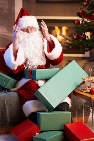 Busy Santa Claus looking lost having too much work to do. Stock Photo - 7899680