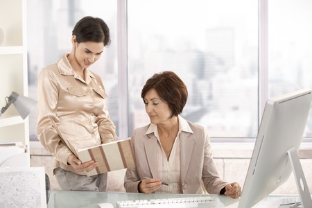 Senior businesswoman working with assistant in office. photo