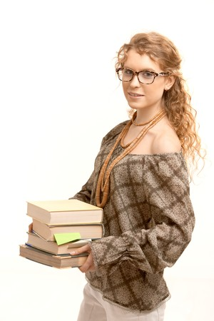Pretty girl wearing glasses with books, studying for exame. photo