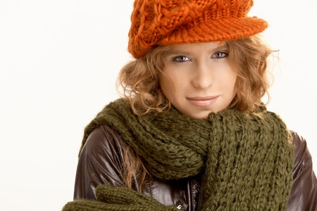 Attractive young woman dressed up warm for winter, wearing hat, gloves, scarf and coat, freezing. photo