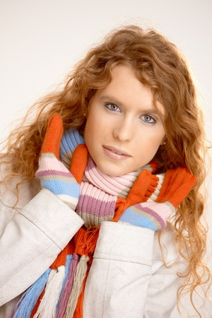 Attractive female dressed up warm in scarf, gloves and coat. Stock Photo - 8083498