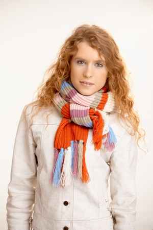 Attractive female dressed up warm in coat and scarf. photo