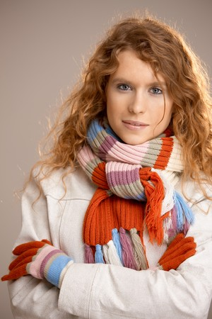 Attractive young woman dressed up warm in scarf, gloves and coat. Stock Photo - 8083500