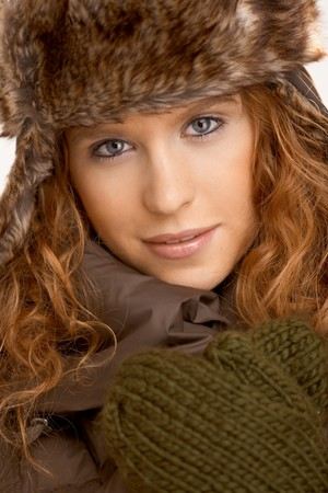 Attractive female dressed up in coat, scarf and fur- hat. photo