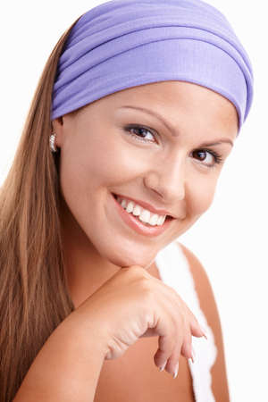 Portrait of attractive young female, smiling, wearing headband. photo