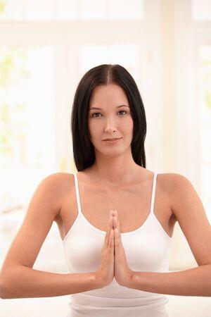 Portrait of young woman at yoga meditation looking at camera, smiling. photo