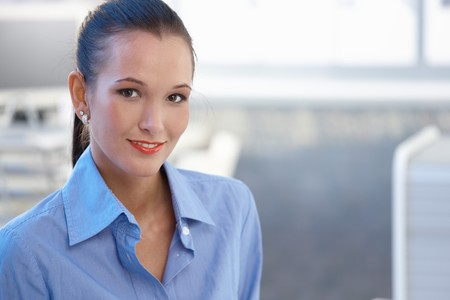 Portrait of attractive young businesswoman smiling at camera, copyspace. Stock Photo - 8121628