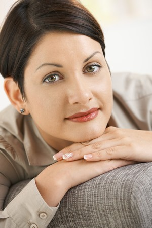 Closeup portrait of attractive woman thinking, leaning on hands, smiling. Stock Photo - 8141808