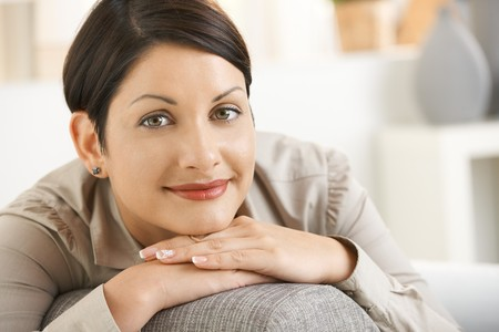 Closeup portrait of attractive woman thinking, leaning on hands, smiling. Stock Photo - 8141686