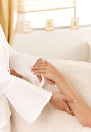 Closeup photo of masseur doing hand massage. photo