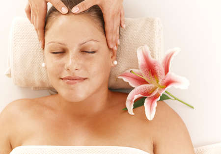 Closeup portrait of relaxed woman getting head massage, smiling. Stock Photo - 8141711