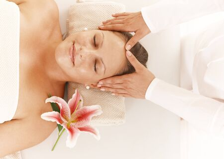 Happy young woman on head massage, smiling. photo