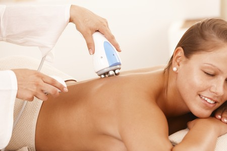 cellulite: Young woman getting radio frequency cellulite treatment in day spa.