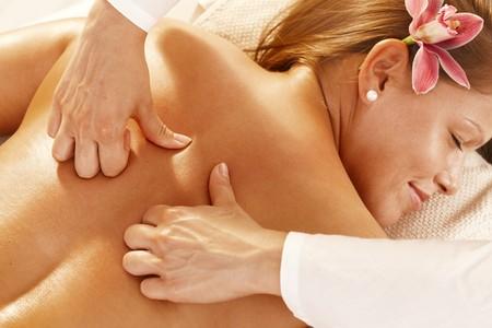 Closeup photo of masseurs hands doing deep tissue massage. photo