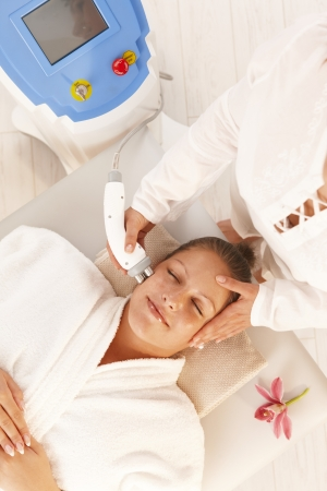 Young woman getting radio frequency cellulite treatment in day spa. Stock Photo - 8141736