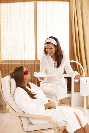 Beautician preparing for cosmetic laser tooth whitening treatment at beauty saloon. Stock Photo - 8141784