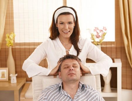 Man getting relaxing head massage in dayspa. photo